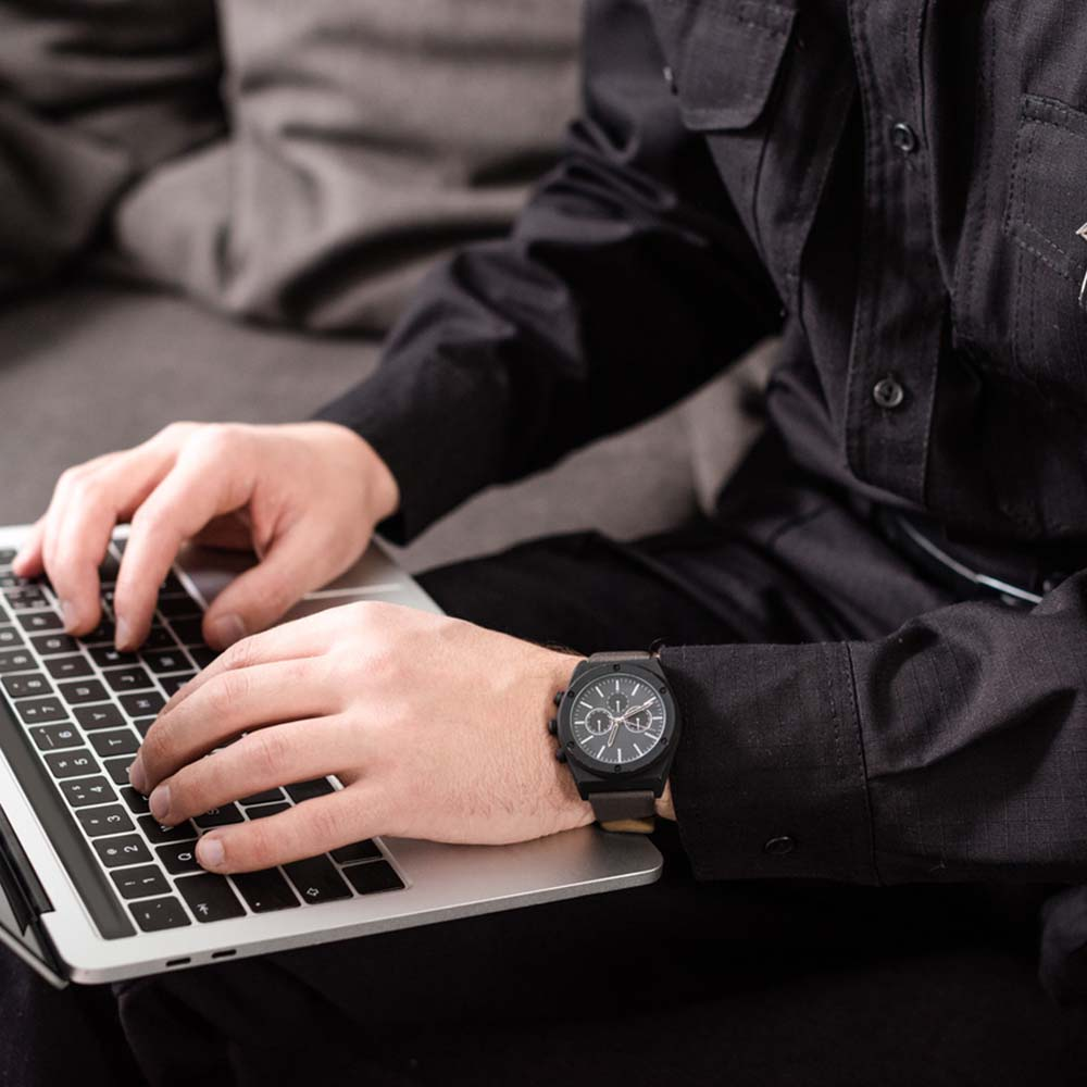 police officer in uniform on computer